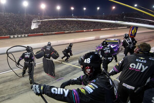 Crew members work the pit